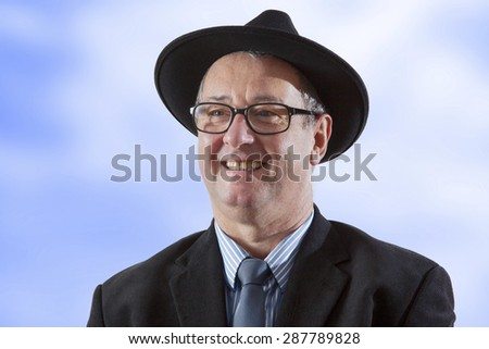 Serious men portrait with hat - stock photo