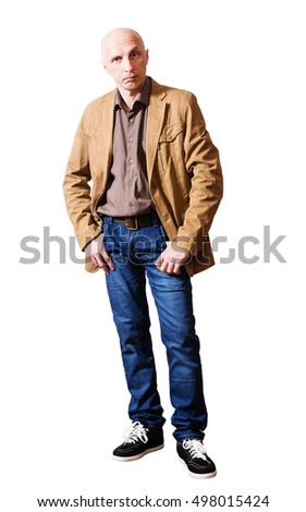 Serious middle-aged man in a yellow jacket and jeans. white background, isolated