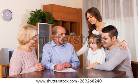 serious multigenerational family dealing with housing problems - stock photo