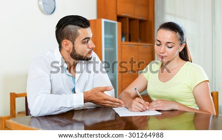 Serious pair discussing problems with contract at home