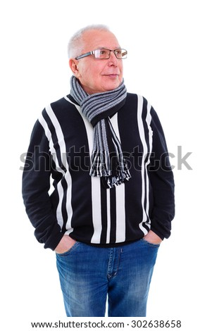 Serious portrait of old senior business man with glasses, dressed in sweater, jeans and scarf on the neck, looking to right, Isolated on white background - stock photo