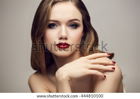 Serious red lips girl