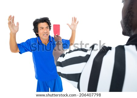 Serious referee showing red ard to player on white background - stock photo
