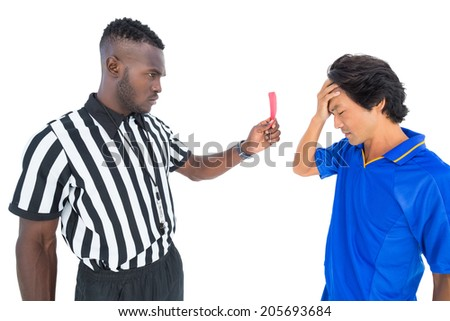 Serious referee showing red card to player on white background - stock photo