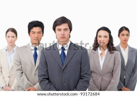 Serious salesteam standing together against a white background
