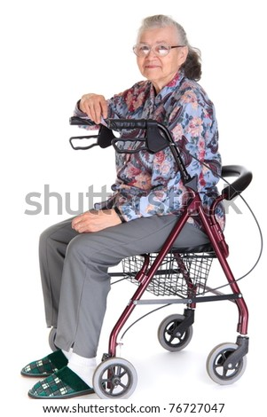 Serious senior citizen woman in combination walker/wheelchair, isolated on a white background. - stock photo