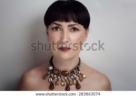 Serious senior woman with perfect anti-age make up, no wrinkles, not tired eyes, slight smile, relaxed face, take care, in-law, mother-in-law. Photo is good for social advertisement about family love. - stock photo