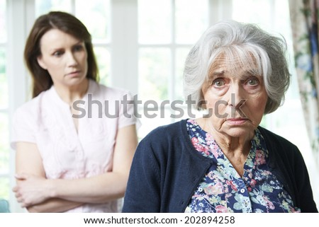 Serious Senior Woman With Worried Adult Daughter At Home - stock photo
