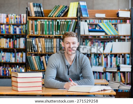 serious student in a library looking at camera