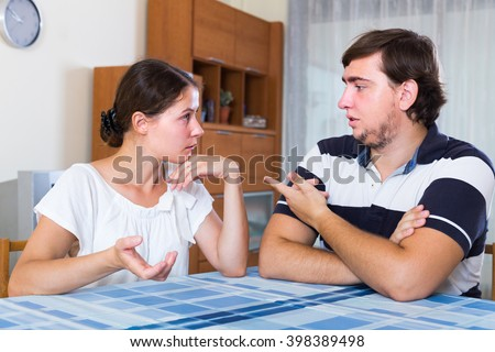 Serious talking about relationships between married couple at home