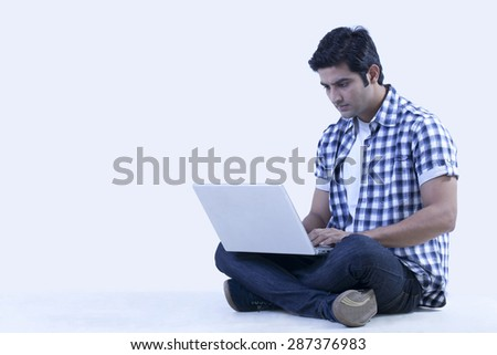 Serious university student using laptop