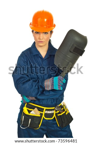Serious welder worker woman holding welding mask against white background