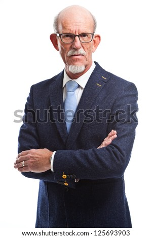 Serious well dressed senior man with glasses. Isolated.