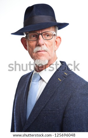 Serious well dressed senior man with hat. Isolated.