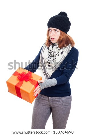 Serious winter woman holding gift box, isolated on white background. - stock photo