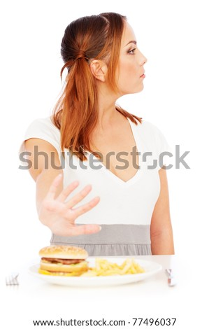serious woman don't want to eat junk food. isolated on white background - stock photo