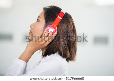 Serious Woman in Headphones Listening to Music