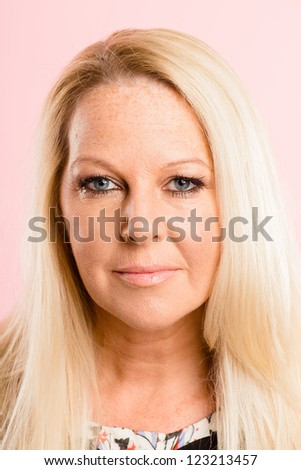 serious woman portrait pink background real people high definition