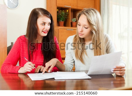 serious women with  documents at table