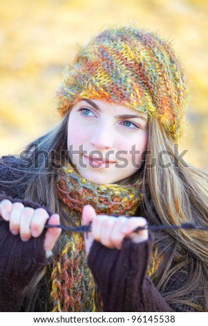 Serious 20 year old woman portrait outdoor in autumn. - stock photo