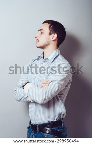 Serious young and attractive businessman  with his hands crossed on his chest - stock photo