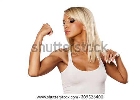 serious young blonde showing her biceps