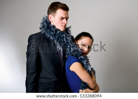 Serious young businessman and partner in a comic situation - stock photo