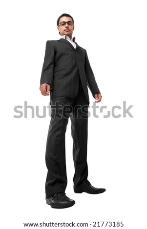 serious young businessman standing against isolated white background