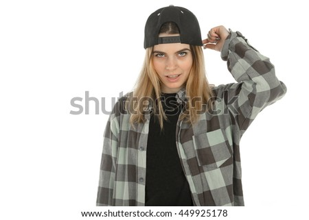Serious young girl looking at the camera in casual clothes isolated on white