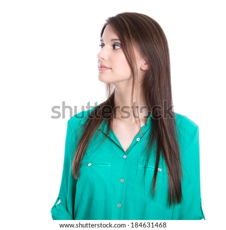 Serious young girl looking at the side in green blouse isolated on white. - stock photo
