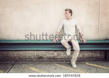 Serious young man - stock photo