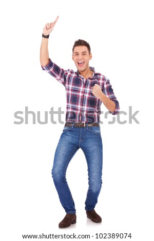 serious young man in casual clothes standing over white background with hands on hips - stock photo