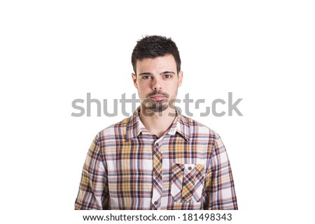 Serious young man isolated on a white background