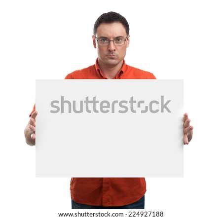 Serious young man showing and displaying placard ready for your text - stock photo