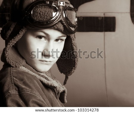Serious young pilot staring at the camera in a confident way - stock photo