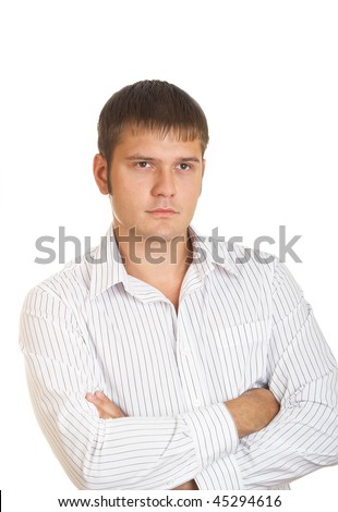 Serious young the man in a white shirt - stock photo