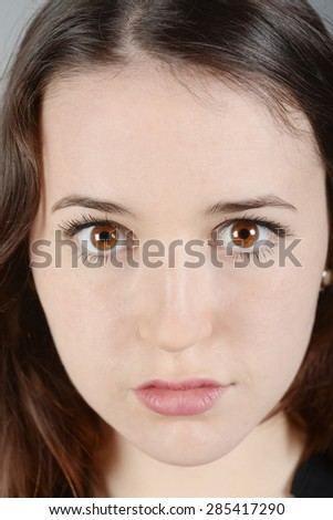 Serious young woman looking at camera