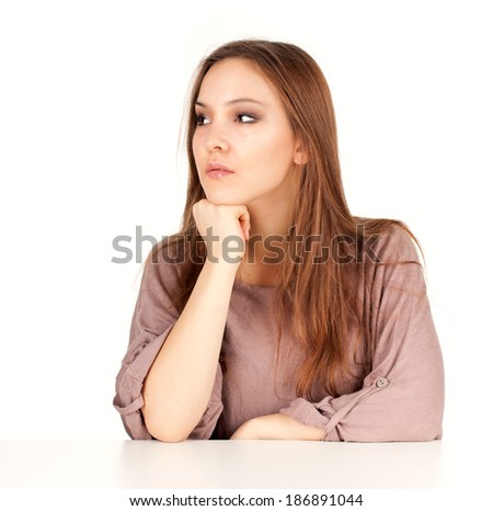 serious young woman looking in side, white background - stock photo