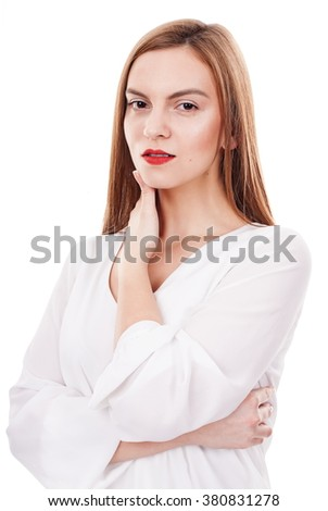 Serious young woman posing relaxed on white background - stock photo