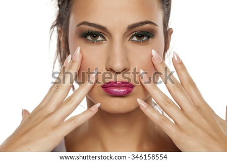 serious young woman showing her nice manicured nails - stock photo
