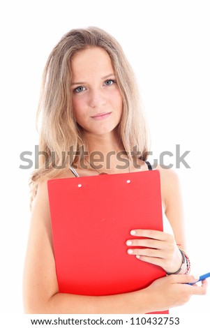Serious young woman student Serious dedicated young woman student with a sincere expression holding a red clipboard isolated on white