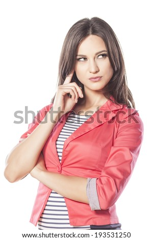 serious young woman thinks with the finger on her face