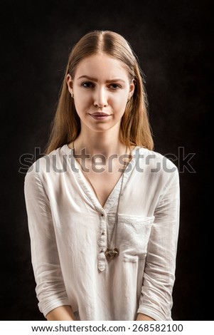 serious young woman with long hair toned - stock photo