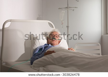 Seriously ill senior man staying in hospice - stock photo