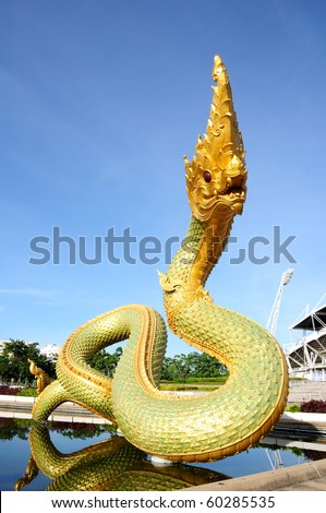 Serpent above the pool with blue sky. - stock photo