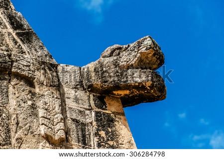 Serpent Head. Chichen Itza archaeological site, Yucatan, Mexico. - stock photo