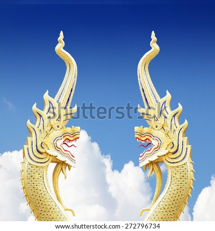 serpent king of nagas statue on blue sky  - stock photo