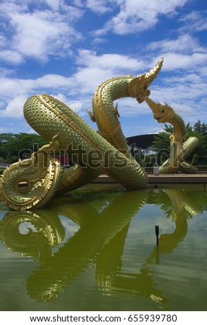 Serpent statue in a sunny day in thailand