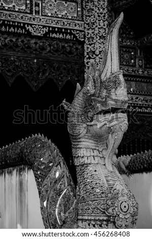 Serpent stucco at Chedi Luang Varavihara temple ,Chaingmai, northern of Thailand. Shoot in black and white shot. - stock photo