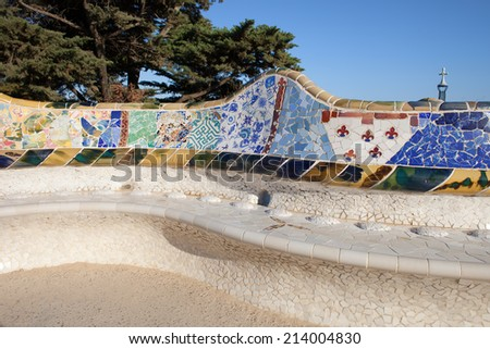 Serpentine Bench with Trencadis mosaic at Antoni Gaudi's Park Guell in Barcelona, Catalonia, Spain. - stock photo